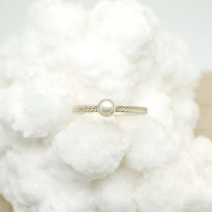 Pearl ring with hand-carved feather textures