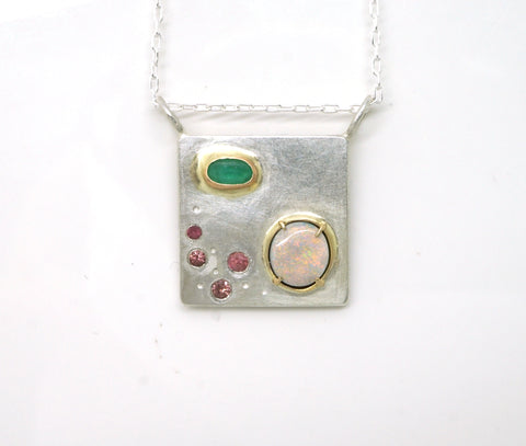 Art pendant necklace with emerald, opal, and tourmaline