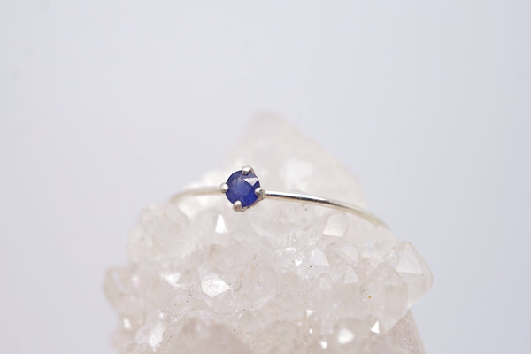 Tiny sapphire solitaire ring