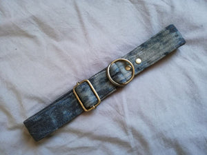 dark cotton denim dog collar with bleached pattern that is finished off with brass hardware and hunt and howlingmoon label