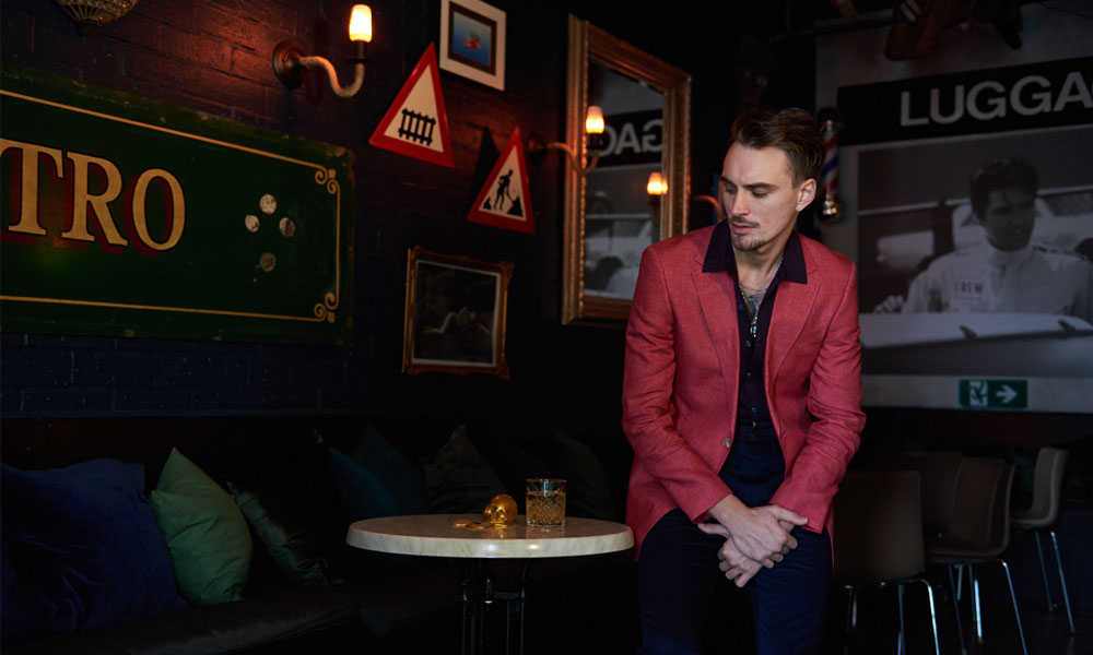 Antoni Topic wears Calibre Raspberry Linen Blazer