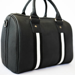 Black premium leather sports bag with black and white leather trim webbing. Gunmetal black hardware.