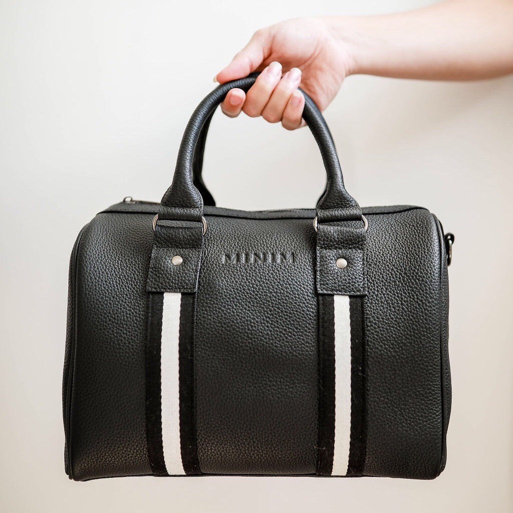 Black premium leather sports bag with black and white sports stripe detailing. Gunmetal black hardware.