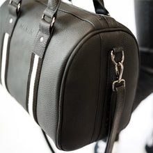 Load image into Gallery viewer, Black premium leather sports bag with black and white leather trim webbing. Long over shoulder leather strap attached to gunmetal black hardware.