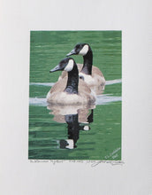 Print of two geese swimming, on coldpress paper, by Judy Link Cuddehe for Found Link Press.