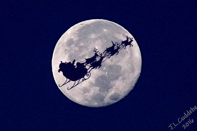 Christmas card of Santa and his sleigh over the Supermoon by Judy Link Cuddehe for Found Link Press. Inside says: