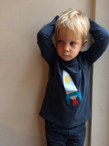 Rocket - Boy wearing navy blue long-sleeved t-shirt with hand applique rocket on the front. -isabee.co.uk