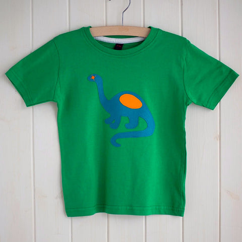 Children's Kelly green cotton t-shirt featuring an appliquéd teal dinosaur with orange details. Dinosaur is reaching its long neck up and the tail is curved around beside. Displayed on a white panelled background. - isabee.co.uk