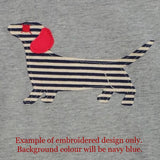 Design detail of children's t-shirt featuring an appliqued, navy and cream striped dachshund with red details. - isabee.co.uk