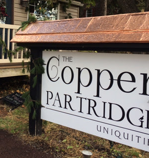 copper roof store sign