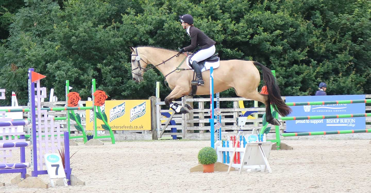 charlotte jumping at the horse trial championships