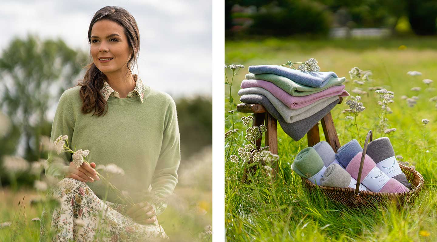 action shots from photoshoot basket full of cashmere scarves and cashmere jumper in grasses