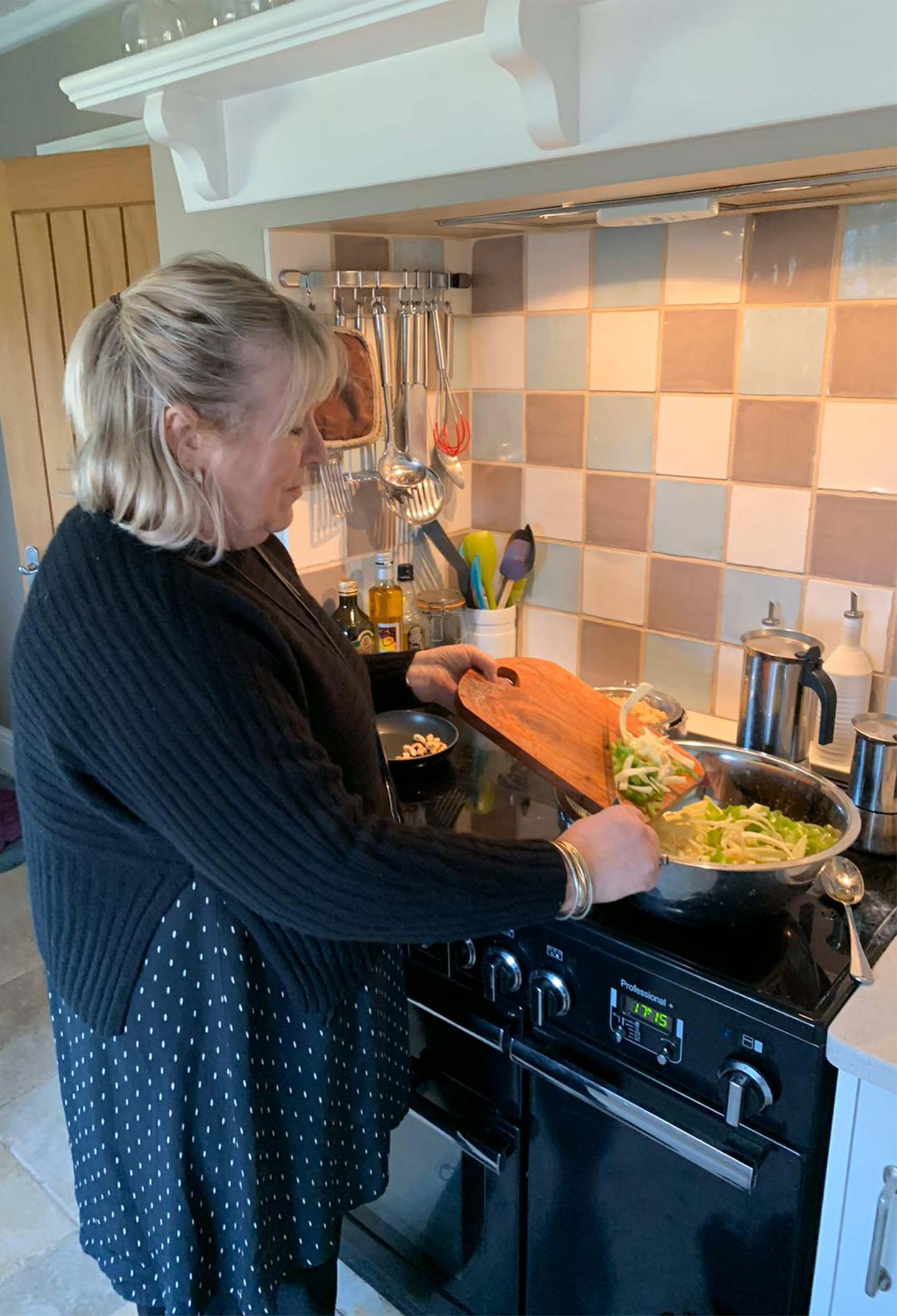 bridget cooking in black cashmere jumper