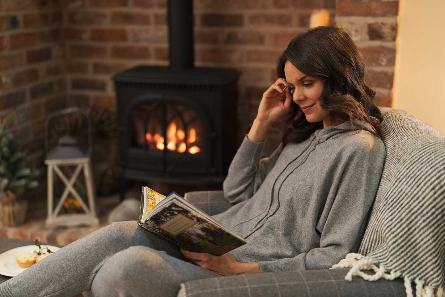 grey cashmere loungewear worn at home reading a book by the fire