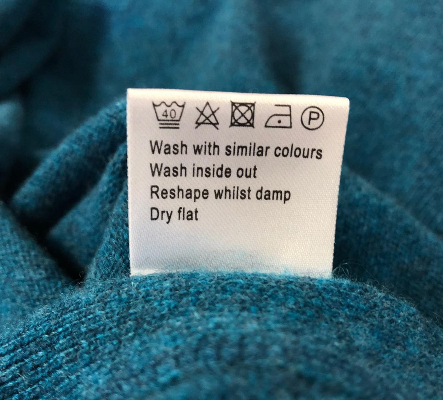 kingfisher cashmere scarf with washing symbols explained on label