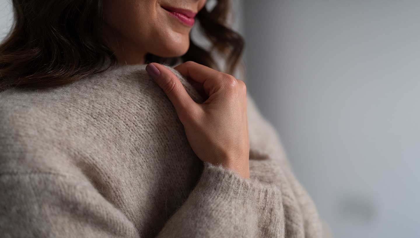 cosy neutral cashmere cardigan worn with cashmere loungewear.jpg