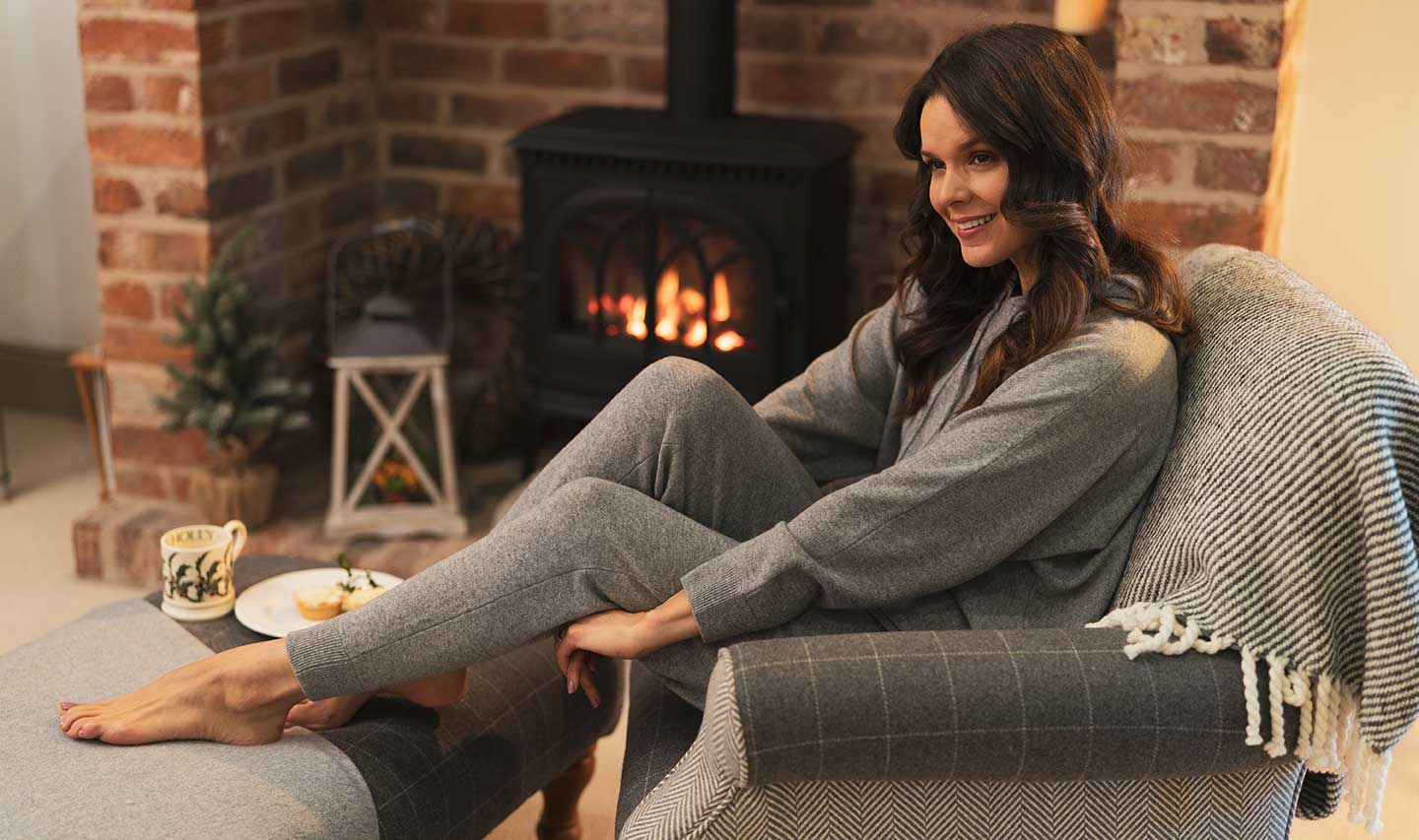 grey cashmere loungewear at home with fire in background