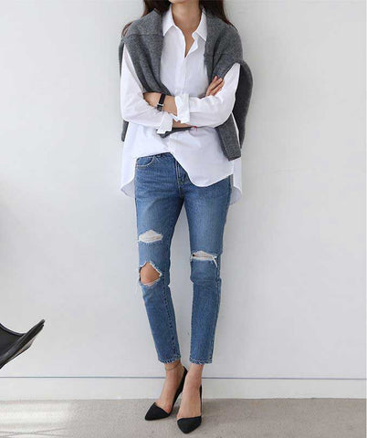 oversized white cotton shirt worn with jeans and grey jumper