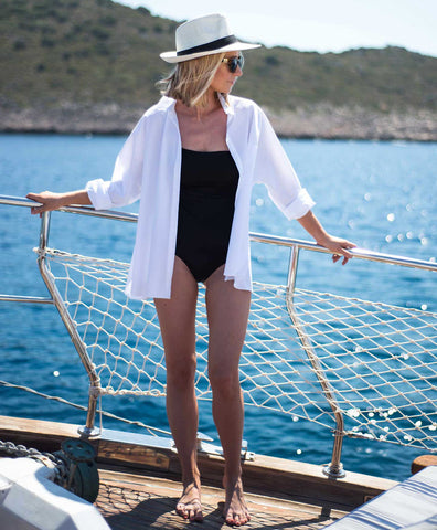 oversized white cotton shirt worn on boat in summer
