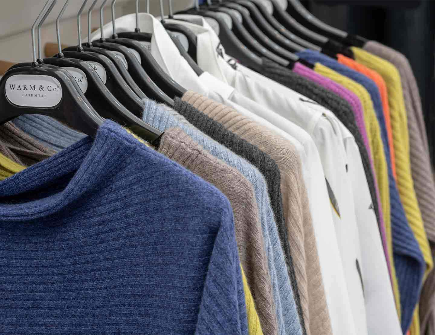 photo of rail of cashmere jumpers