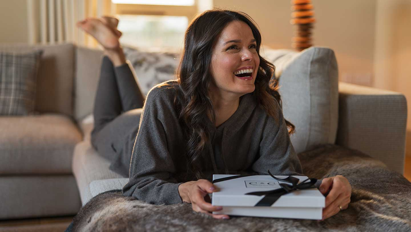 taupe cashmere loungewear worn at home on the sofa reading a book