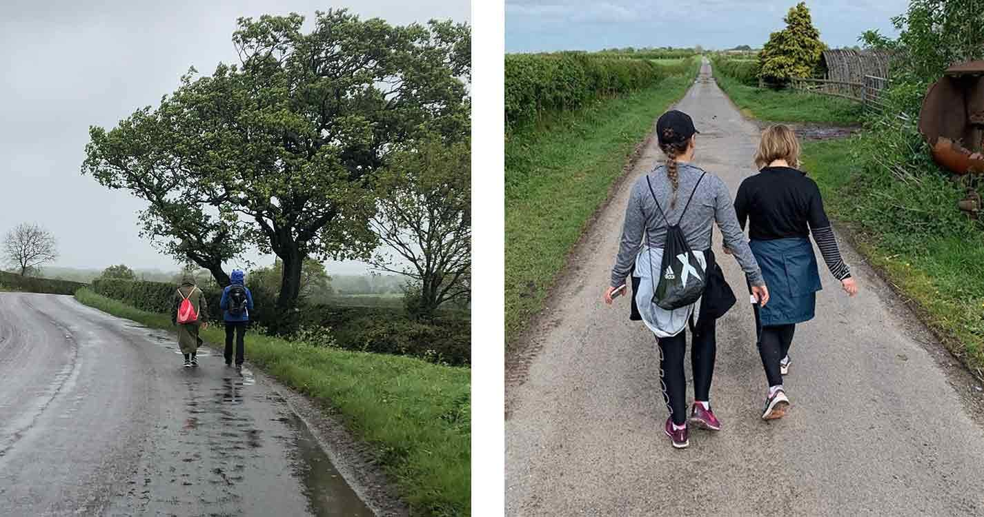 two-women-walking-down-a-narrow-road-next-to-a-hedge-in-sportswear-training-for-the-moonwalk-2019
