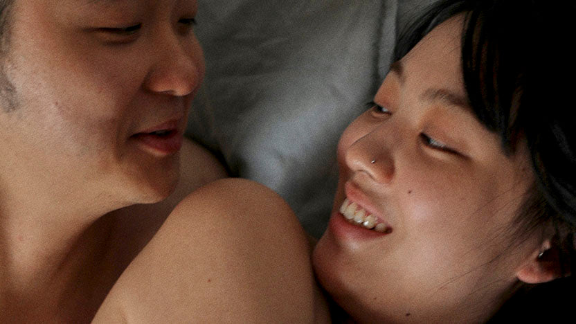 man and woman laying on bed
