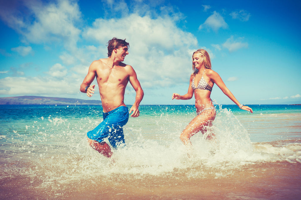 Couple running along a beach