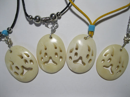Carved bone bear paw