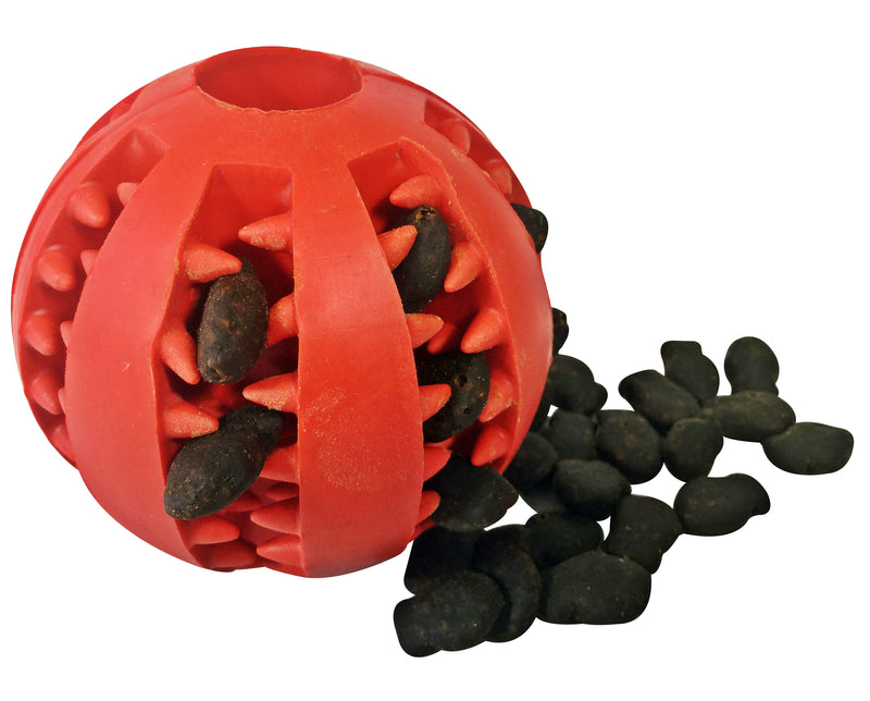 A Dog Treat Ball Dispenser Toy filled with Grain Free Fish Training Treats and a pile of treats beside the ball.