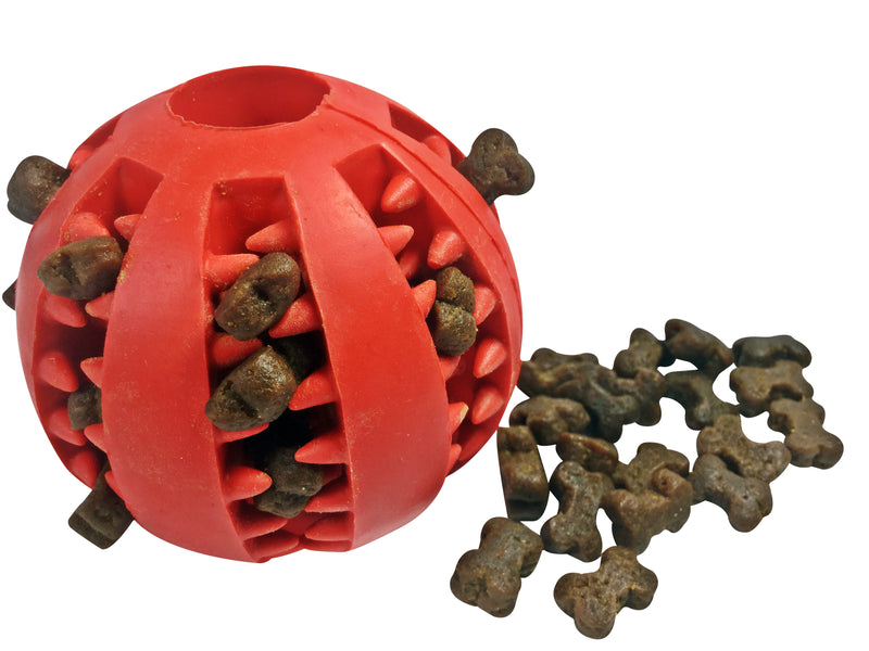 A Dog Treat Ball Dispenser Toy filled with Grain Free Poultry Training Treats and a pile of treats beside the ball.