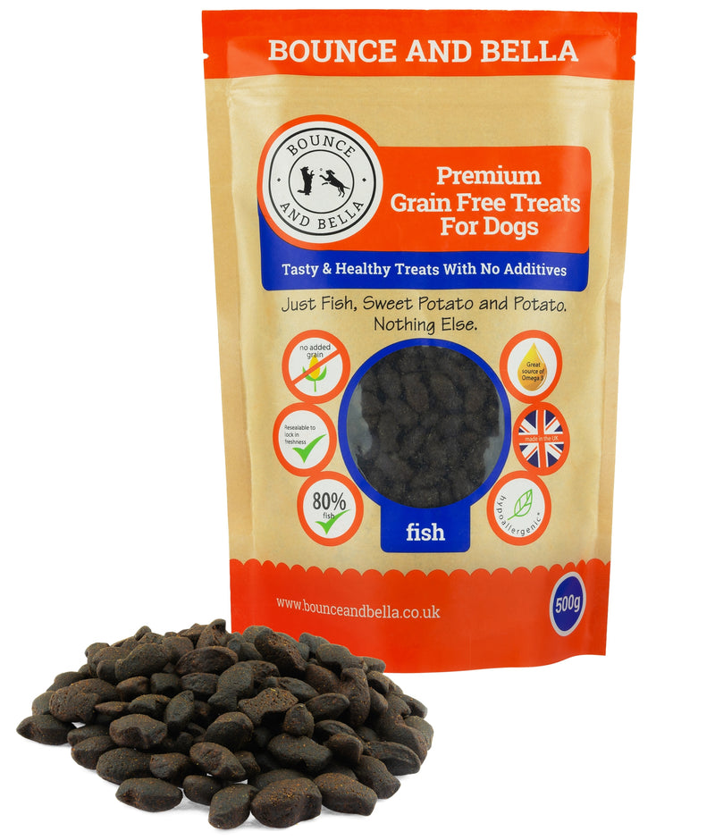 A packet of Grain Free Fish Training Treats for Dogs.Besides the packet is a small pile of the fish treats.