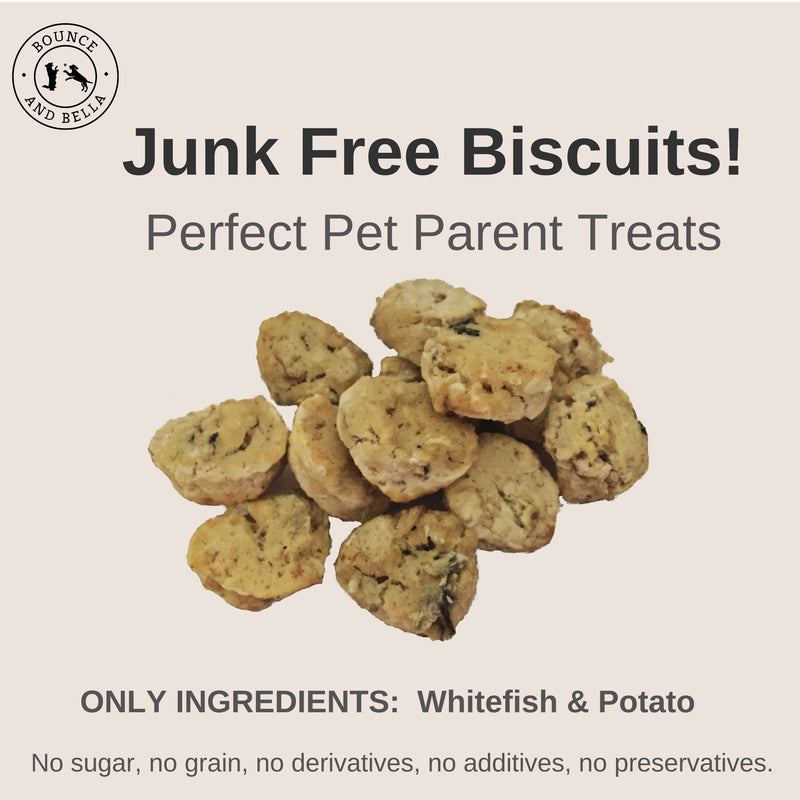 An infographic featuring the main image as a pile of Whitefish and Potato Cookies. Above the image is the title: Junk Free Biscuits! Perfect Pet Parent Treats Below the image is the caption: Only Ingredients: Whitefish and Potato. 0% Junk - No Grain or Gluten, No Sugar, No Additives and No Preservatives.