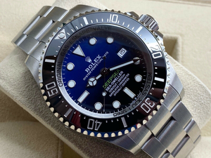 GENTS ROLEX SEA-DWELLER D-BLUE STICKERS 10 YEAR WARRANTY 2031 UK