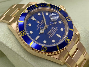 GENTS ROLEX SUBMARINER DATE 18CT YELLOW GOLD NEW OLD STOCK 2005 UK