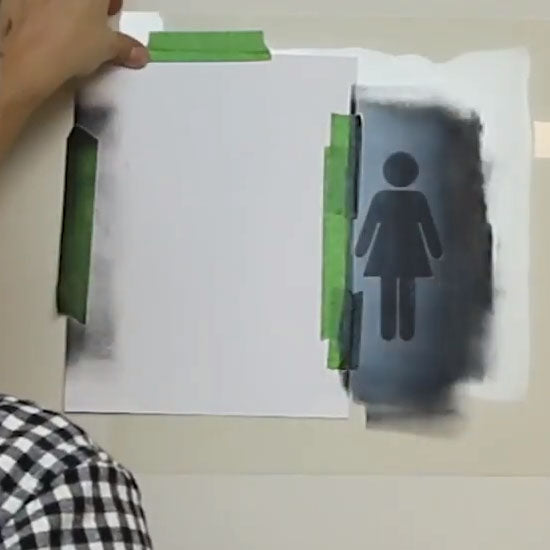 Marking Restroom Doors with Women & Men Stencil