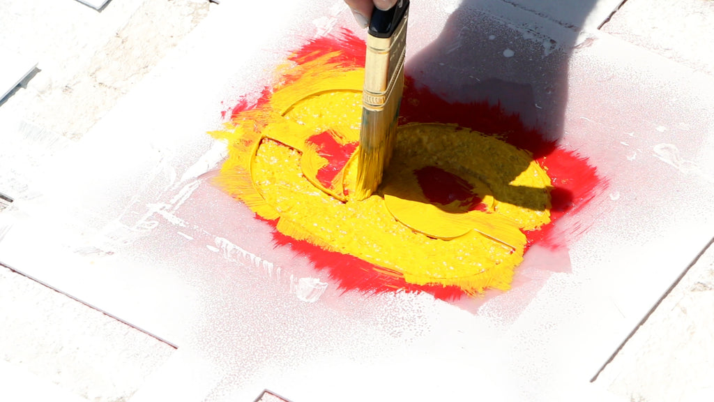 Paint the secondary color of paint through the stencil
