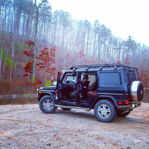 mercedes benz g wagon gobi racks stealth roof rack with ladder and light bar in forest
