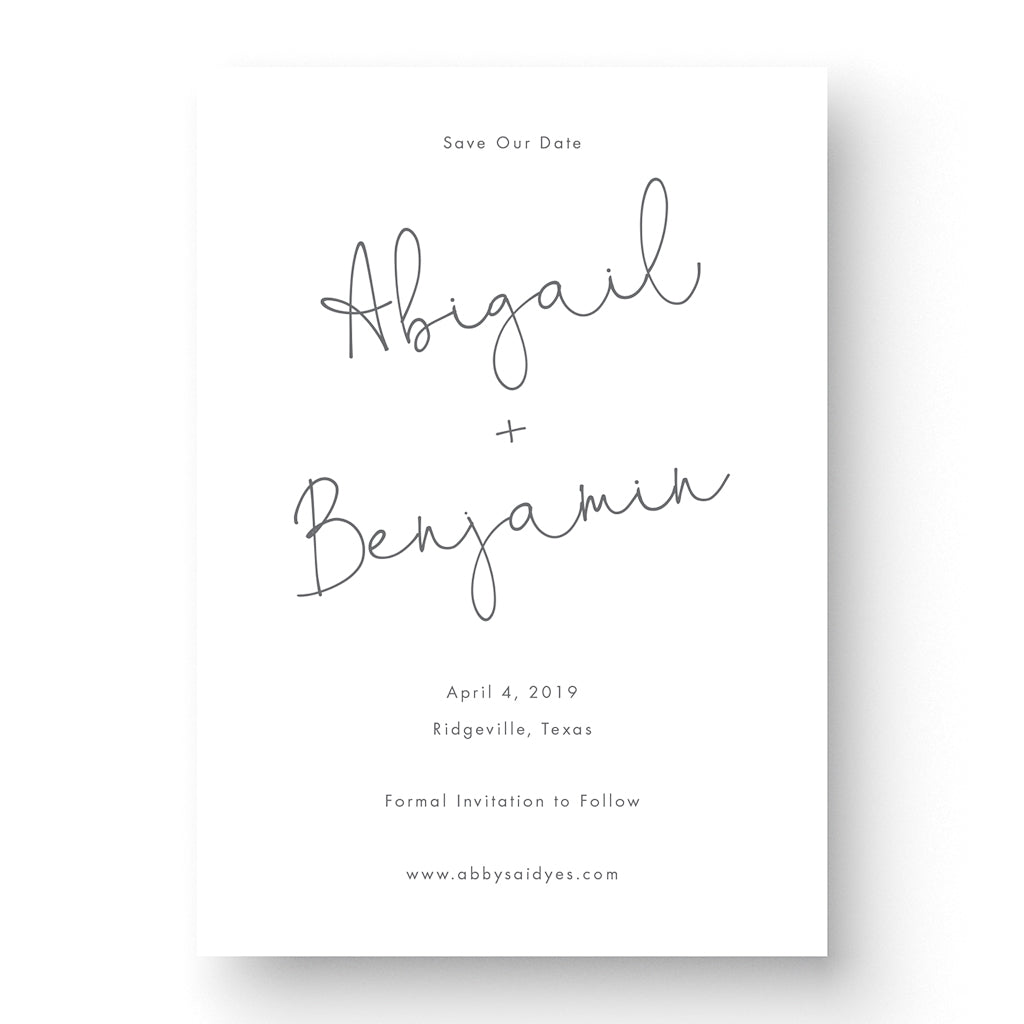 romantic save the date card with script font on white paper