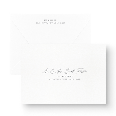 romantic save the date card envelopes with calligraphy script on white stock