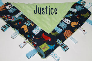 Monsters on a lime minky taggie blanket