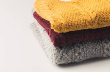 neatly stacked sweaters