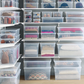 stacks of clear storage bins