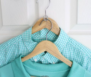 two light blue shirts on hangers
