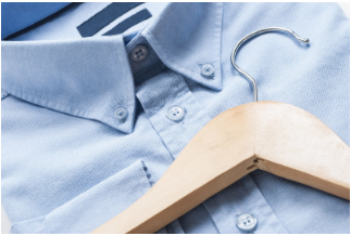 wooden hanger on a shirt