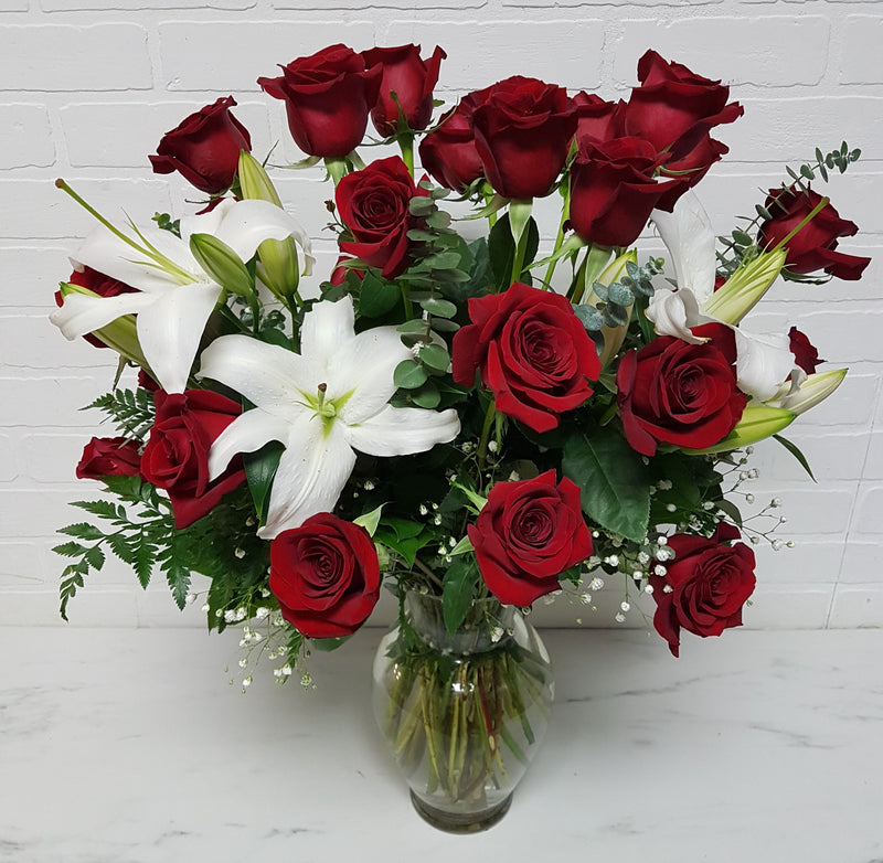 24 Roses and Lilies Deluxe -Vase Arrangement