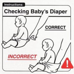 checking baby's diaper with finger