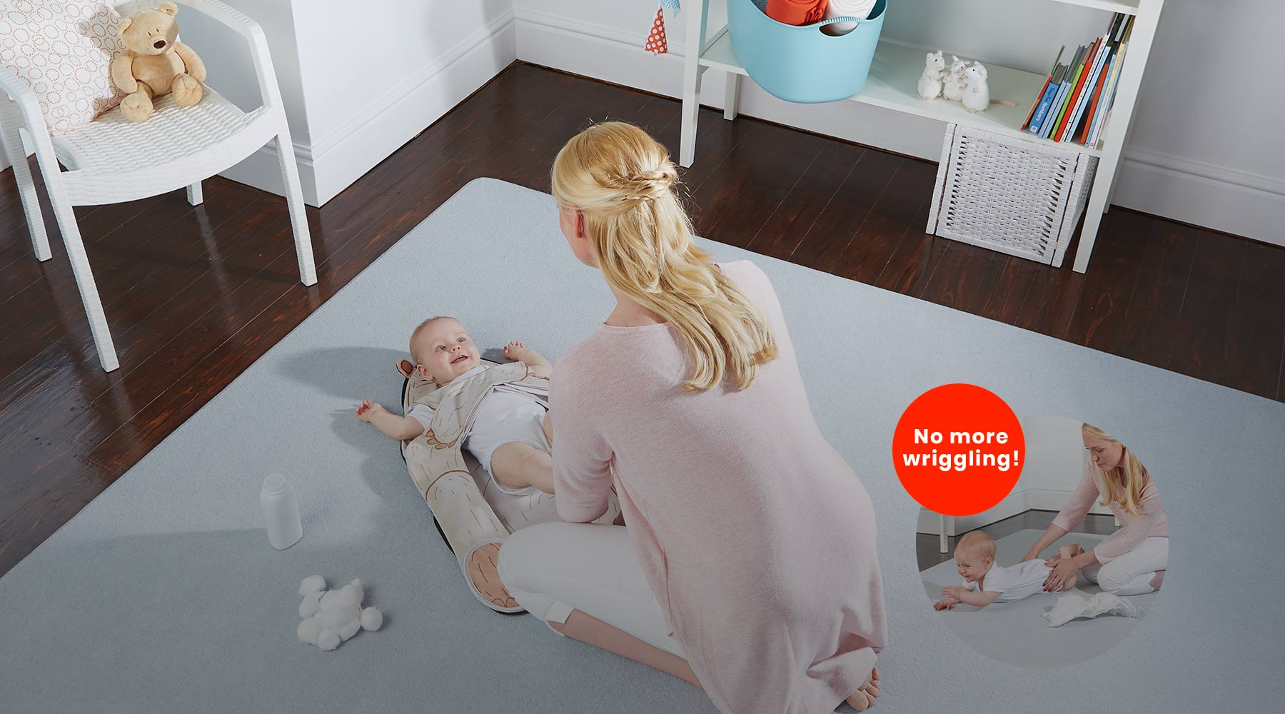 Mother changing baby diaper using The Wriggler changing pad