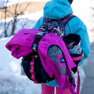 My Fave Jacket Strap holding ski pants on a  backpack