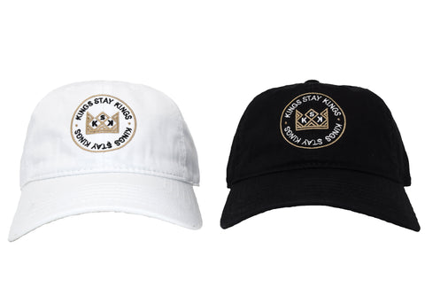 Kings Stay Kings logo on a white dad hat and a black dad hat.